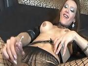 Lustful shemale in stockings jizzes