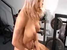 Cute blond tranny rides cock in gym