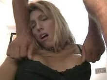 Blonde shemale gets cumload on tits